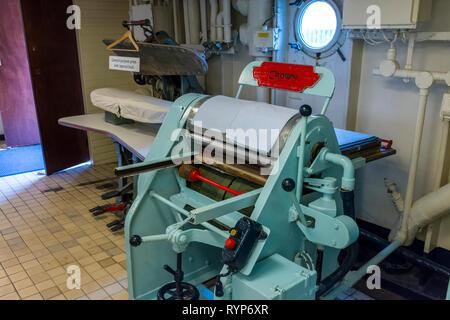 Garment presses in the laundry, Royal Yacht Britannia, Port of Leith, Edinburgh, Scotland, UK - Stock Image