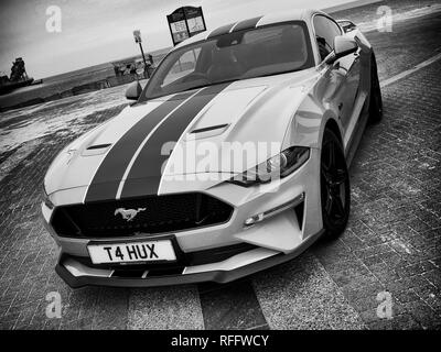 A current model 5th generation Ford Mustang sports car at a classic car event in Great Yarmouth - Stock Image