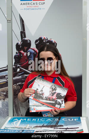 Portsmouth, UK. 23rd July 2015. A volunteer sells programmes for the America's Cup at the Portsmouth Historic - Stock Image