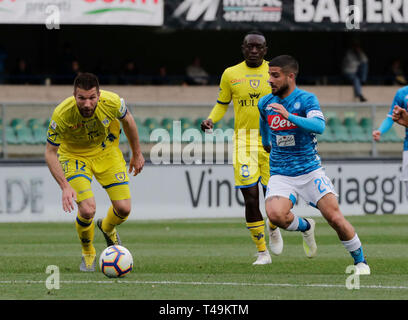 Verona, Italy. 14th Apr, 2019. Stadio Marcantonio Bentegodi, Verona, Italy. 14th Apr, 2019. Serie A football, Chievo versus Napoli; Lorenzo Insigne of Napoli and Bostjan Cesar of Chievo challenge for the ball Credit: Action Plus Sports Images/Alamy Live News - Stock Image