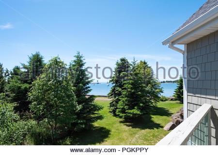 View of Grand Marais harbor from the balcony of a Cobblestone Cove condominium - Stock Image