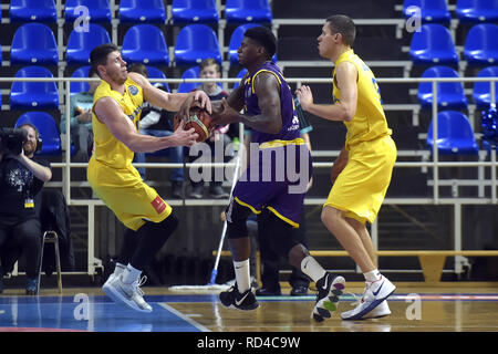 Opava, Czech Republic. 16th Jan, 2019. (L-R) Rostislav Dragoun of Opava, DeQuan Jones of Hapoel and Ludek Jurecka of Opava fight for a ball during the Group B, 11th round of the Champions League match BK Opava vs Hapoel Holon in Opava, Czech Republic, January 16, 2019. Credit: Jaroslav Ozana/CTK Photo/Alamy Live News - Stock Image