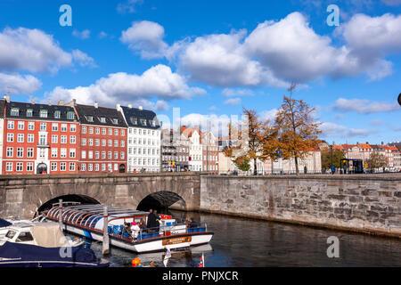 Netto-Bådene Boat Trip under a bridge in the canal in Nybrogade, Copenhagen, Denmark - Stock Image