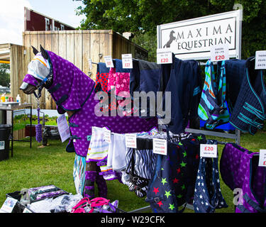 90th Kent County Show, Detling, 6th July 2019. A horse mannequin dressed in a full length purple rug with other rugs on display also. - Stock Image