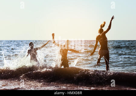 Friends fun party beach sunset group - Stock Image
