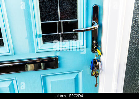 Keys in door, keys in lock, keys, security, door lock, bunch of keys, house door keys, house door lock, door handle, letterbox, composite door, key, - Stock Image