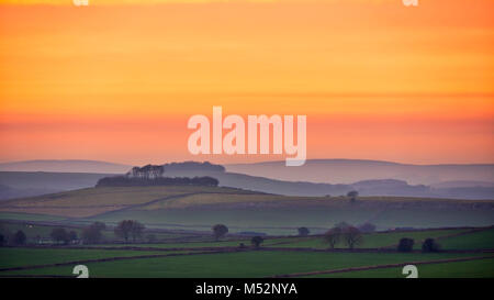 Sunset over Minning Low hill Historic England monument with a chambered tomb & two bowl barrows viewed from - Stock Image