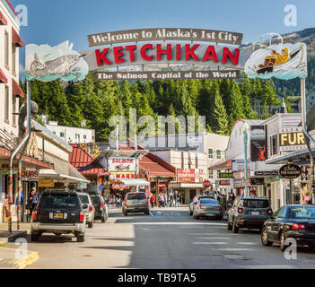 September 17, 2018 - Ketchikan, AK: City welcome sign, shops and vehicles on busy Mission Street, near Cruise ship docks. - Stock Image