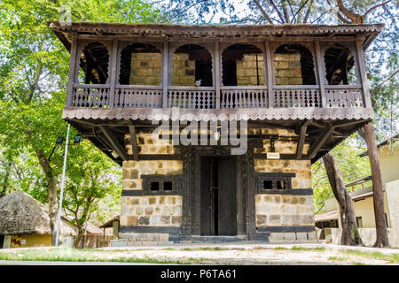 Stone hut typical of Mandi area of Kulu region, Himachal Pradesh, in the National Crafts Museum, New Delhi, Delhi, India - Stock Image