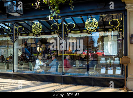 Exterior of Betty's famous café tea room in Harrogate North Yorkshire with diners in thw window having morning coffee - Stock Image