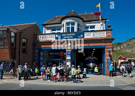 Old RNLI Lifeboat Station and Museum on Whitby seafront. - Stock Image
