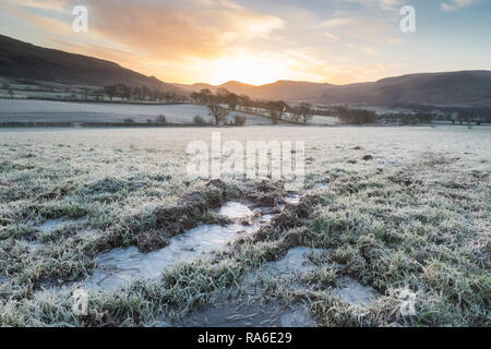 Stirlingshire, Scotland, UK. 2nd Jan, 2018. UK Weather: Frozen puddles on a very cold morning in Stirlingshire, Scotland Credit: Kay Roxby/Alamy Live News - Stock Image