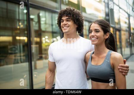 Beautiful sporty couple running and jogging outdoor - Stock Image