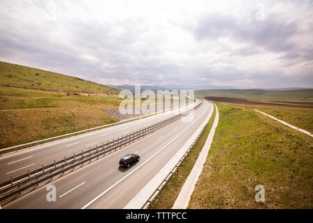High angle view of car on highway against sky - Stock Image