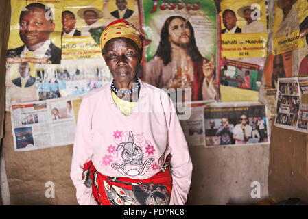 Elderly woman stares at the camera in her in southwest Uganda, Africa - Stock Image