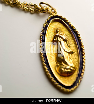 A beautiful medalion with a golden saint. - Stock Image