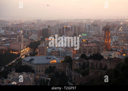 Cityscape skyline of Malaga Old town and Cathedral at sunset, Malaga Andalusia Spain - Stock Image