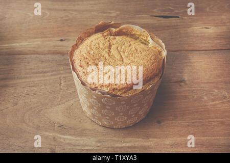 Homemade egg cupcake on wooden table - Stock Image