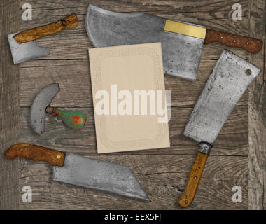 vintage kitchen knives and utensils over wooden  board, blank card for your text - Stock Image