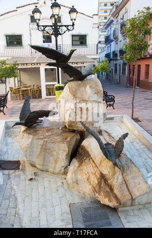 Small rock and Seagull fountain in the Plaza braille, Fuengirola, Costa del Sol, Spain. - Stock Image