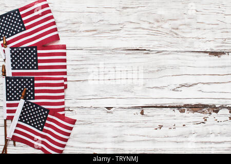 American Flags for the America's 4th of July Celebration over a white rustic background to mark America's Independence Day. Image shot from top view. - Stock Image
