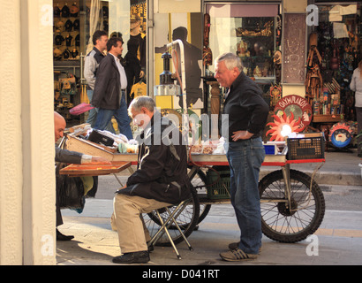 Street scene of Greek men playing backgammon, Athens - Stock Image