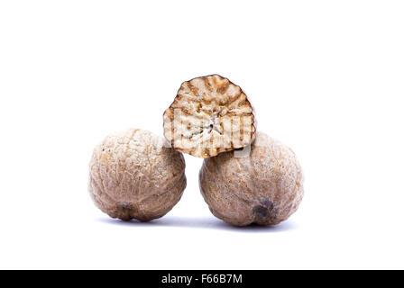 Nutmeg isolated on white background closely. - Stock Image