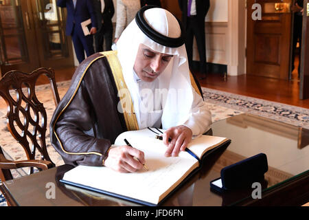 Saudi Foreign Minister Adel al-Jubeir signs U.S. Secretary of State Rex Tillerson's guestbook before their bilateral - Stock Image