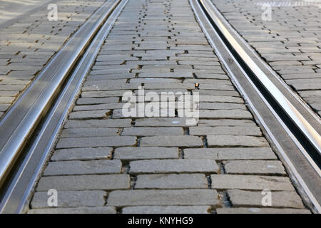 The tram rails on the paved street surface are visible in Bern, Switzerland - Stock Image