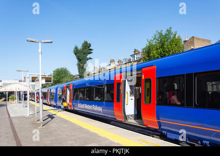 Train on platform, Putney Railway Station, High Street, Putney, London Borough of Wandsworth, Greater London, England, United Kingdom - Stock Image