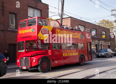 TORONTO,CANADA-NOVEMBER 01,2016: Red double decker tour bus. Several people on the bus enjoying the sights of Toronto. - Stock Image