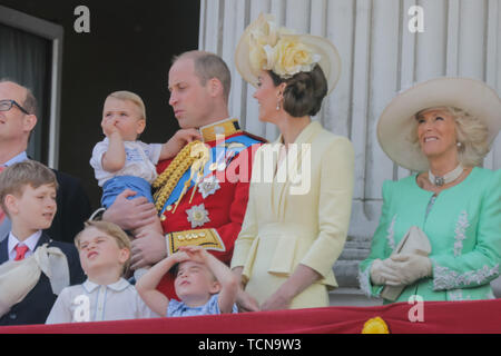 One year old Prince Louis sucks his thumb on his debut public engagement. Appearing on the Buckingham Palace balcony, with his parents, TRH The Duke and Duchess of Cambridge, and his siblings, Prince George and Princess Charlotte. Trooping the Colour, The Queen's Birthday Parade, London, UK - Stock Image