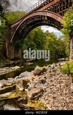 UK, Cumbria, Sedbergh, Brigflatts, redundant stone and iron railway bridge of Ingleton Branch Line, crossing River Rawthey closed in 1950s - Stock Image