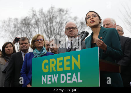 U.S. Rep. Alexandria Ocasio-Cortez of New York, along with other members of Congress announce the Green New Deal legislation during a press conference outside the Capitol Building February 7, 2019 in Washington, D.C. - Stock Image