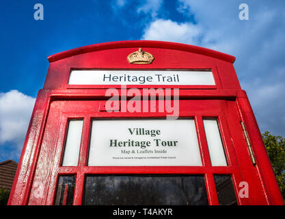 A telephone box in the village of Comberbach, Cheshire, Uk converted into a heritage tour for tourism. - Stock Image
