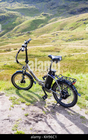 A FreeGo Folder power-assisted bicycle resting in Cumbria UK - Stock Image