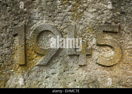 Year 1945 carved in the stone. The years of World War II. - Stock Image