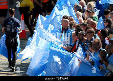 Manchester City fans await the trophy parade in Manchester. - Stock Image