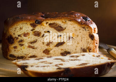 Barmbrack or bairin breac a traditional Irish fruit loaf made with sultanas and raisins often eaten buttered for afternoon tea and traditionally serve - Stock Image
