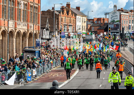 Birmingham, UK. 17th March, 2019.  The Birmingham St. Patrick's Day parade took place today in front of 90,000 people amidst sun and heavy hail showers. The parade snaked past the old custard factory. Credit: Andy Gibson/Alamy Live News. - Stock Image