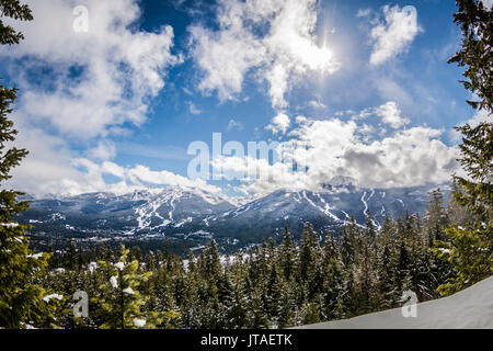 View of blue skies over Whistler Blackcomb from Sprout Mountain, British Columbia, Canada, North America - Stock Image
