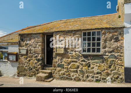 St Leonard's Chapel (also known as The Fisherman's Chapel) stands on Smeaton's Pier in St Ives, Cornwall, England. - Stock Image