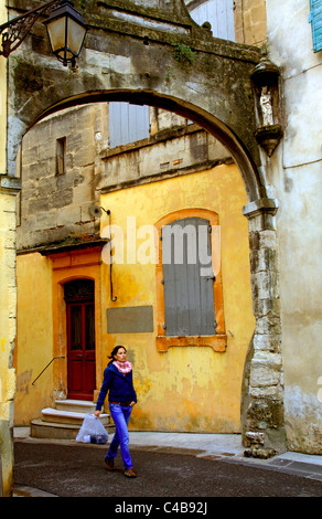 Arles; Bouches du Rhone, France; A young woman walking along the old streets. MR. - Stock Image