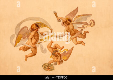 COMO, ITALY - MAY 11, 2015: The detail of baroque fresco of angels with the  instruments of martyrium in church Chiesa di San Orsola. - Stock Image