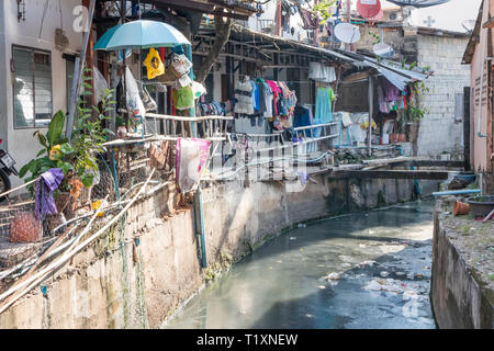 Phuket, Thailand 21st January 2019: Polluted canal by the side of dwellings in Phuket Town. Pollution is a big problem throughout Asia. - Stock Image
