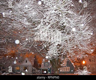 Falling Snow in a Neighborhood - Stock Image