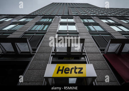 MONTREAL, CANADA - NOVEMBER 3, 2018: Logo of Hertz on their main office for Montreal, Quebec. Hertz is a car rental company from the USA spread worldw - Stock Image
