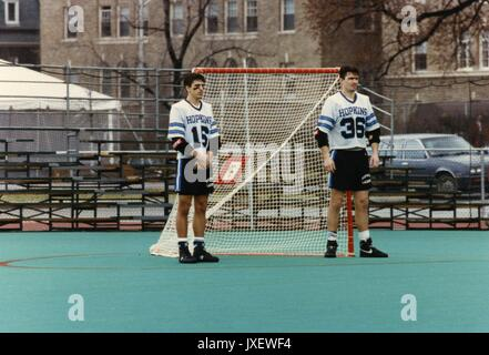 Lacrosse, Wills, Jeff, Lukacz, Brian Jeff Wills (#16) and Brian Lukacz (#36), the 1992 captains of the lacrosse team are standing in front of the goal post where a small flag memorializing Hopkins war dead was placed, 1992. - Stock Image