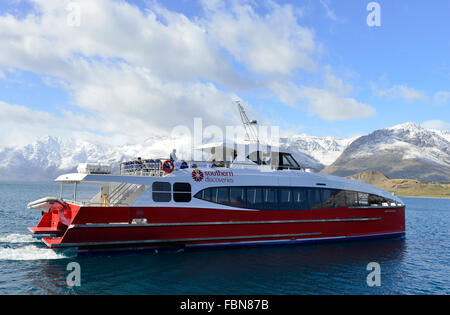 Southern Discoveries ferry on a Lake Wakatipu cruise with the surrounding mountains providing a dramatic backdrop - Stock Image
