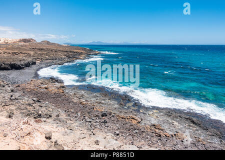 Landscape with rocky costline at Fuerteventura on Canary Islands - Spain - Stock Image